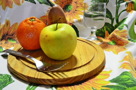 mixed fruits on white tablecloth flowers photo