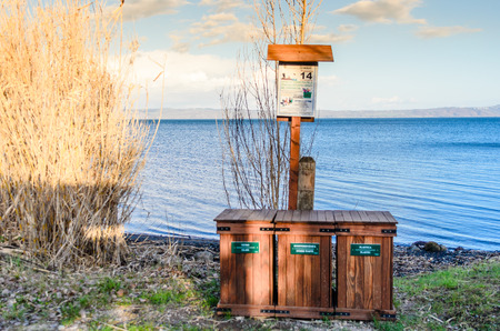 wooden baskets for recycling, on the shores of Lake Bolsena, a tourist place to protect and safeguard. Stock Photo