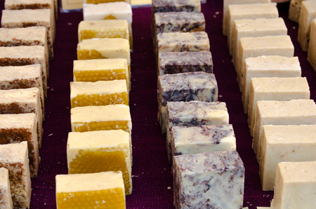 display of handmade soap cubes in a stand of a flea market Stock Photo