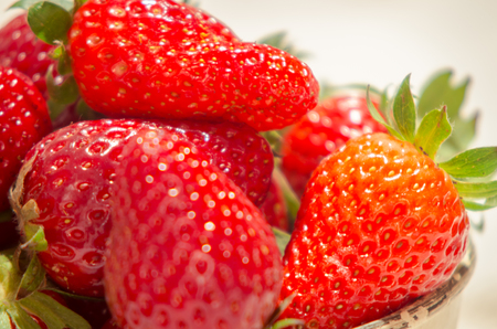 fresh strawberries on a bucket and white tablecloth Stock Photo