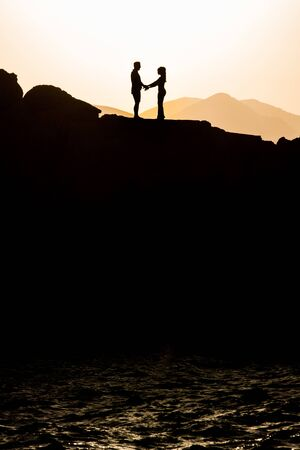 Couple in love hugging in the sunset. Wedding in Majorca by the sea.