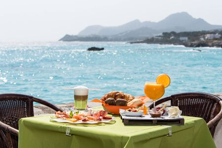 Salty and sweet brunch in front of the sea