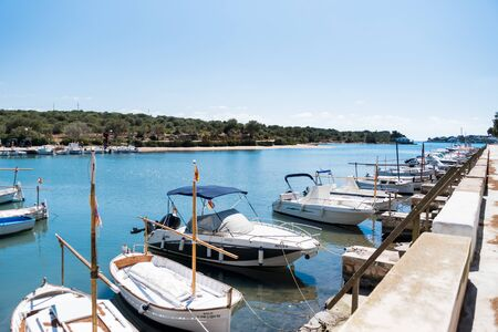 View of port and boats with blue sky, Portocolom, Lonely beach with blue sky, Cala de la Bella Dona, Majorca