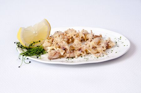 A plate of chipirones on a white background