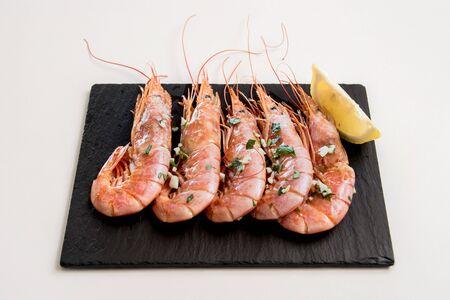 A prawn dish on a white background