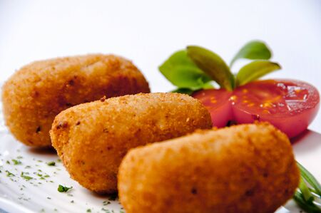 Croquettes plate on a white background
