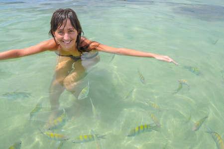 Young Women swimming with tropical Fish. Bahia, Boipeba Brazil. South America, photo