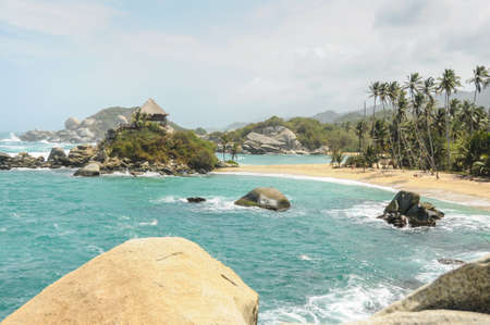 Traveling through national Park. Colombia wonders beautiful golden beach at Tropical Jungle. photo