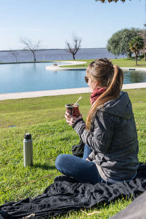 mate drink: Enjoying Mate drink looking at the river. Buenos Aires. Argentina. Stock Photo