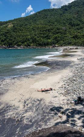 brazil beach swimsuit: Lolenly beach at Brazil paradise. Rio do Janeiro. South America.