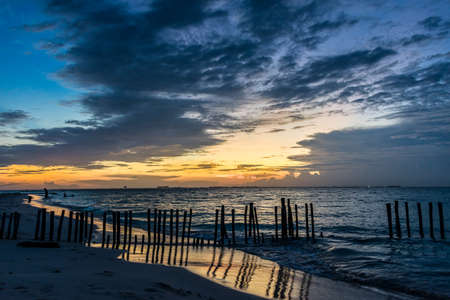 mujeres: Sunset with people swimming at Caribbean Island. Mexico, Cancun. Stock Photo