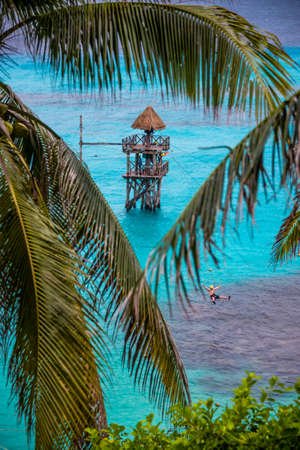 mujeres: Going down a zip wire over the caribbean Sea. At Isla Mujeres Mexico. Stock Photo