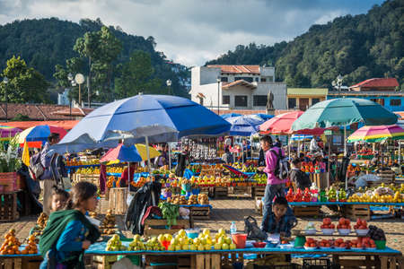 SAN JUAN CHAMULA, MEXICO - DICEMBER 2 San Juan Chamula, inhabited by indigenous Tzotzil Maya people, traditional market, selling fruits and hand crafts on Decemeber 2, 2014 in San Juan Chamula, Mexico.