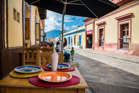 Restaurant view and sidewalk on San Cristobal de las Casas colonial town. Latin American Culture.