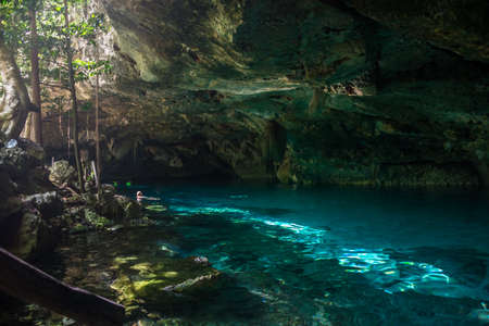 Blue fresh water at cavern near Tulum. Cenote dos Ojos. Stock Photo