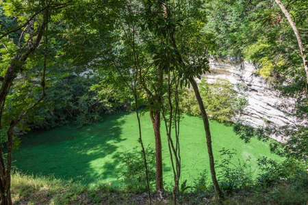 Latin America Adventure. Green Cenote at Mayan site. Sacrifice well. Stock Photo