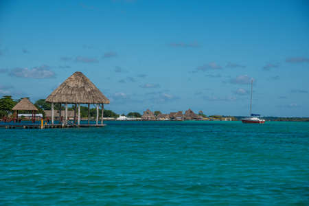 wooden dock: Beautiful wooden Dock at Bacalar Lake traveling riviera maya. Mexico adventure.