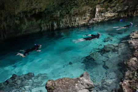 free diver: Adventure in Cavern Fresh Water. Near PLaya del Camren. Mexico Adventure.