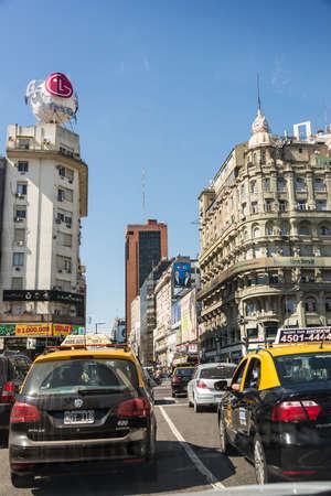 corrientes: Buenos Aires, Argentina - April 9, 2015: Driving through Corriente Avenida, famous central avenue on April 9, 2015 in Buenos Aires, Argentina