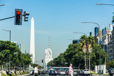 obelisco: Buenos Aires, Argentina - April 9, 2015: Unidentified business people walking down the street at iconic building  Obelisco on April 9, 2015 in Buenos Aires, Argentina Editorial