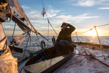 sailing: Adult relaxing leisure activity. Sailing South America.