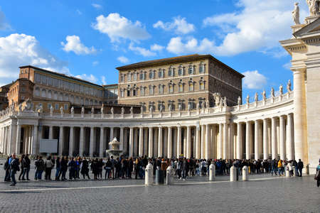 Vatican City. February 11, 2017. St. Peters Square (Piazza San Pietro) Tourist in a long waiting line to get into the museum