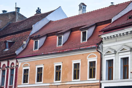 Typical romanian House with tiled roof. Brasov, Romania. Stock Photo