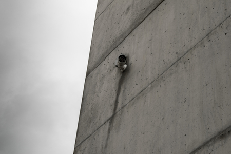 CCTV camera on concrete wall