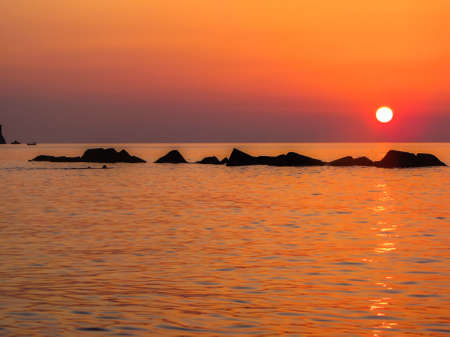 Magical Sicilian sunset. In Capo d'Orlando, province of Messina, Sicily, Italy 免版税图像
