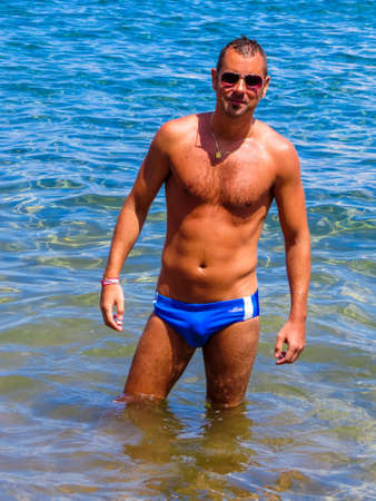 Sexy Italian Man on the Beach Banco de Imagens