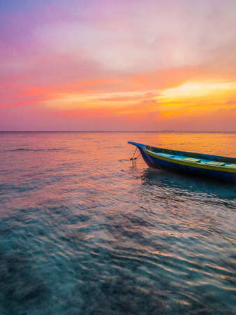 Fisherman's boat at sunset in the atoll of Ukulhas, Maldives