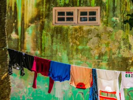 Clothes hanging out to dry in the village of Villingili, Maldives