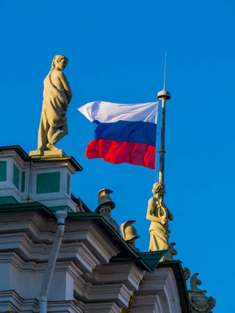Waving Russian flag on the top of the Hermitage Museum in St. Petersburg, Russia