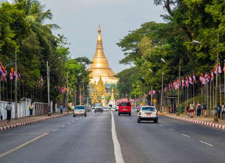 YANGON, MYANMAR - JANUARY 4, 2018: View of the Shwedagon Pagoda road with the Shwedagon Pagoda itself in the background. Sajtókép