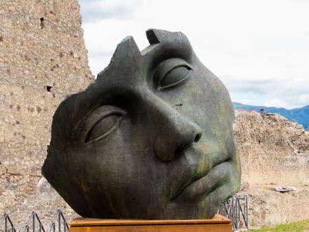 Sculpture of the Polish sculptor Igor Mitoraj on display at Pompeii archaeological site, Campania, Italy