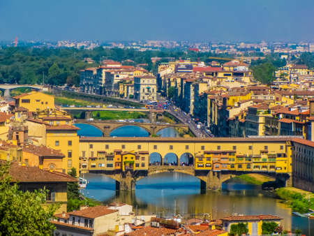 Summer aerial view of the old town and the Arno River in Florence, Italy