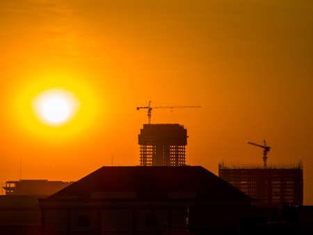 Construction cranes at sunset. In Phnom Penh, Cambodia Banque d'images