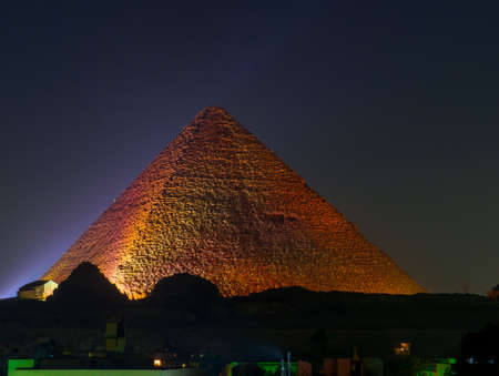 Cairo, Egypt - November 31, 2019: View of the Great Pyramid of Giza illuminated at night. Éditoriale