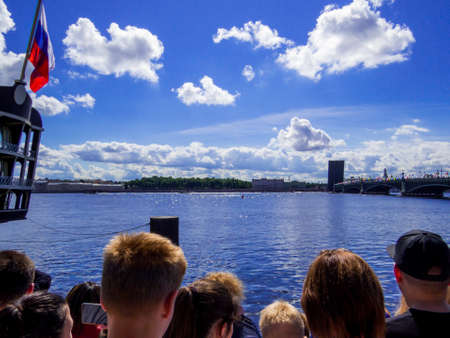 St. Petersburg, Russia - July 26, 2020: People watching the annual celebrations for the Navy Day on the embankment of the Neva River. Éditoriale