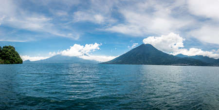 Panoramic view of Atitlan lake with volcanoes in the background - San Marcos la Laguna, Guatemala
