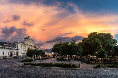 colonial church: Sunset at Central Park - Antigua, Guatemala Stock Photo