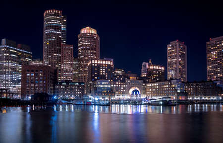 Boston Harbor and Financial District skyline at night - Boston, Massachusetts, USA