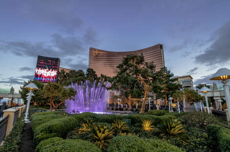 nv: Fountains in front of Wynn Hotel and Casino at sunset - Las Vegas, Nevada, USA