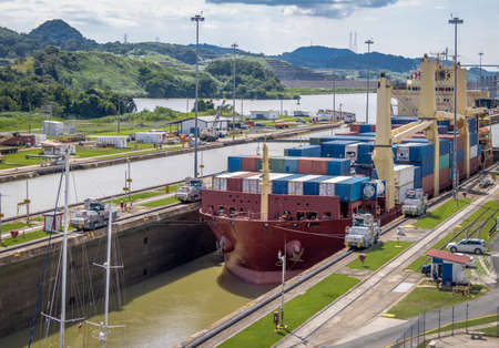 Ship crossing Panama Canal being lowered at Miraflores Locks - Panama City, Panama
