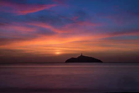 marta: Sunset view of the lighthouse in an island - Santa Marta, Colombia