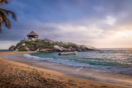 marta: Sunrise and beach hut at Cape San Juan - Natural Tayrona National Park, Colombia
