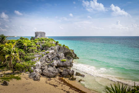 God of winds Temple and Caribbean beach - Mayan Ruins of Tulum, Mexico Stock Photo