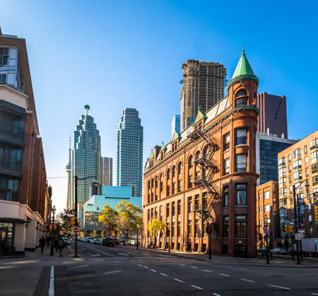 Or Gooderham Flatiron Building in downtown Toronto with CN Tower on background - Toronto, Ontario, Canada Stock Photo