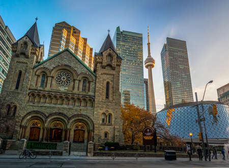 Panoramic view of St Andrews Presbyterian Church and CN Tower - Toronto, Ontario, Canada