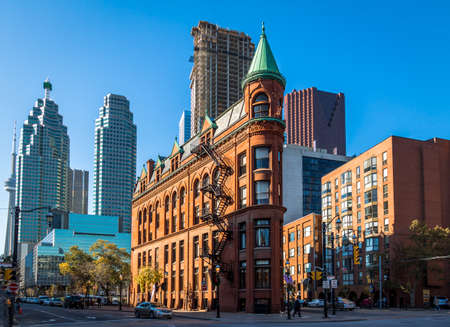 Or Gooderham Flatiron Building in downtown Toronto with CN Tower on background - Toronto, Ontario, Canada 写真素材